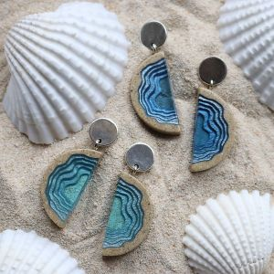 Inspired by Australia's stunning coastline, each design has been carefully handcrafted from beach sand to resemble a different coastal landscape.