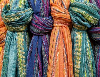 Add color, dimension, and  texture with our beautiful scarves.  Perfect for gifts!