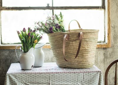 This classic market basket, hand woven in Morocco will be the favorite go-to shopping or beach bag.